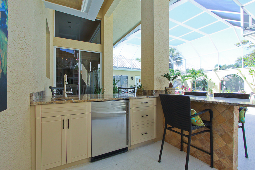Outdoor Tropical Kitchen Remodel in Bonita Bay, FL by Progressive Design Build